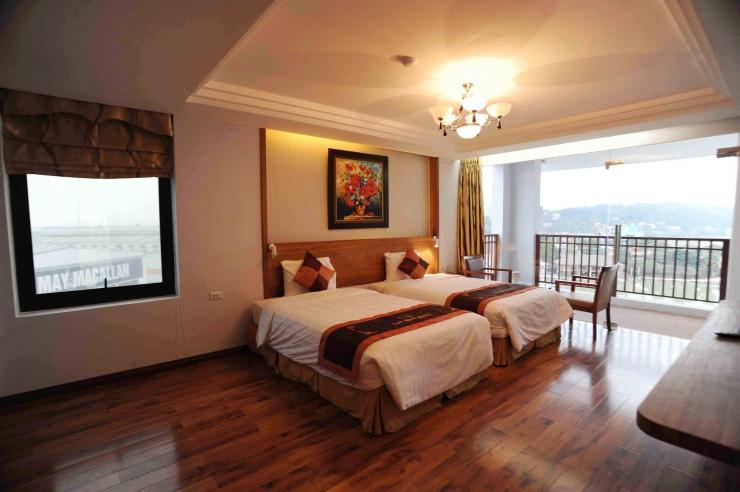 Không gian phòng ngủ thoáng đãng tại resort Văn Minh